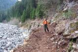 A volunteer backcountry patrol ranger hikes along the Carbon River