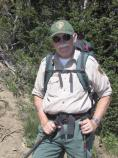 Volunteer Jim Burns patrols trails at Sunrise