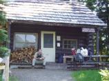 A backcountry ranger relaxes in front of the ranger station at Mowich Lake