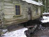 A channel of Ipsut Creek flowed directly beneath the cabin, undermining its foundation.