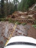 Debris litters Highway 123 on the first day of the storm.