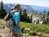 SCA Rainier Recovery Corps member Sam Keller looks out over the landscape while meadow roving at Paradise.