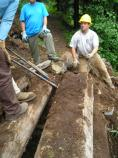 Volunteers help rebuild a damaged section of trail in Stevens Canyon, in Mount Rainier National Park.