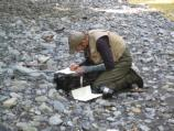Olympic National Park fisheries biologist Sam Brenkman records data during Elwha River snorkel survey.