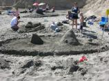 2010 Sand Sculpture Contest: Adult/Family Group Entry #41: Man with Shark, by Flightless Manicotti