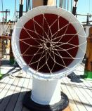 A cowl vent on the main deck of BALCLUTHA increases air circulation below decks. Deckhand Ali Maheu fashioned this bit of netting across the opening. It is another example of Ali's fancywork, sophisticated knotwork, that serves a utilitarian purpose.