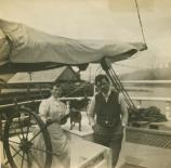 Captain Ole Monsen, wife Martha, and their dog Topsy at the helm of a lumber schooner.SFMNHP K09.6.734p