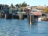 The town of Friday Harbor and the Washington State Ferries dock are captured on a clear morning from a departing ferry.