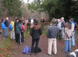 Park staff and volunteers receive a safety briefing before starting work on a new puncheon (walkway) that will corss a forest wetland.