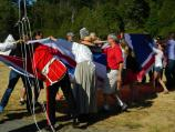 Stewart Goodin (in scarlet tunic) leads visitors and re-enactors in folding Union Flag.