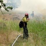 Fire crew member keeps in touch by radio.