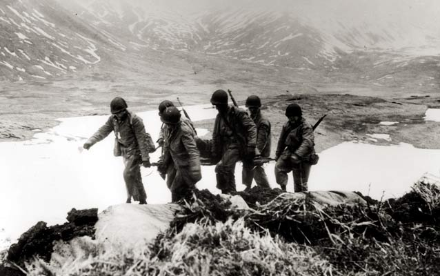 US soldiers carrying a casualty during the battle to recapture Attu from the Japanese in May 1943.