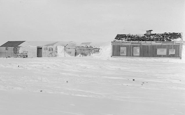 Worksheds and houses on Flaxman Island, Alaska, during winter