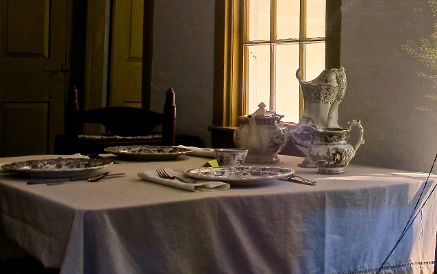Dishes set on the kitchen table inside the Clara Barton Homestead