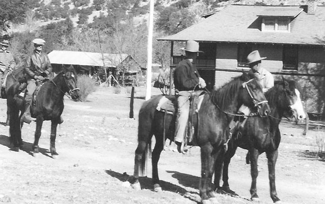 Faraway Ranch in 1919, with three people on horseback in front of ranch buildings