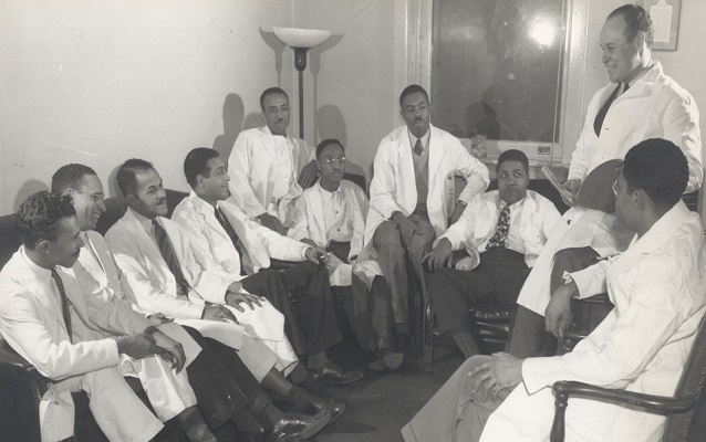 Dr. Charles Drew (top right) talks to a group of young doctors