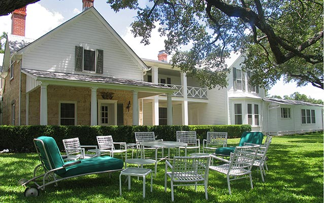Lawn chairs  sit in a circle in the front yard of the Texas White House.