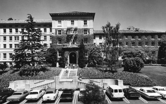Exterior view of a large hospital building with ivy growing up the front.