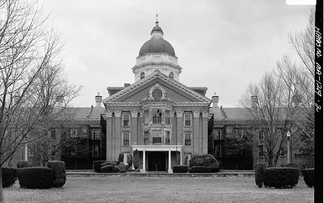 Exterior of a large building with a dome