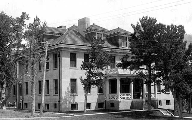 Black-and-white photograph of the third hospital, a three-story, brick building.