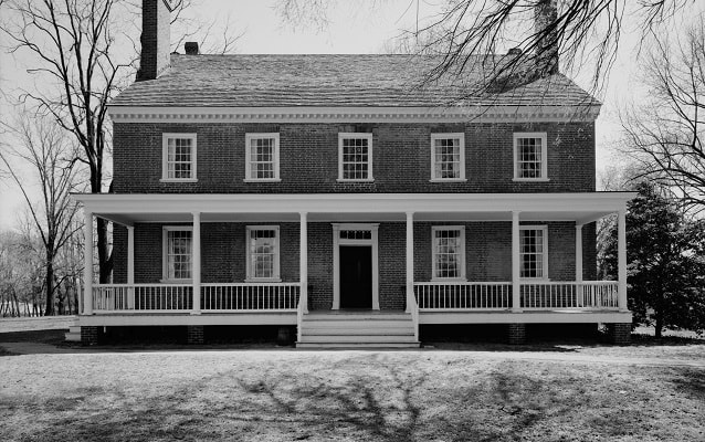 black and white photo of locust grove esterior