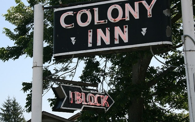 neon sign for the colony inn, which once occupied the Amana hotel