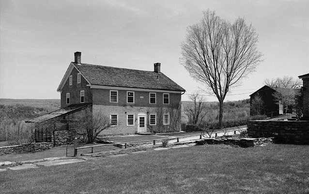 black and white photo of a shaker building in tyringham