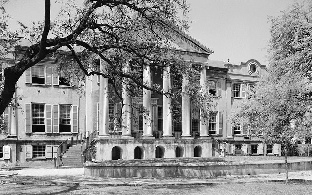 Black and white photo of library with Greco-Roman style columns.