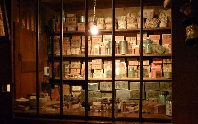 Window display of historic medicine bottles and boxes.