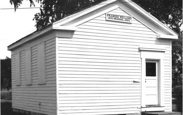 Small, one-room schoolhouse made of wood, painted white. Courtesy NPS.