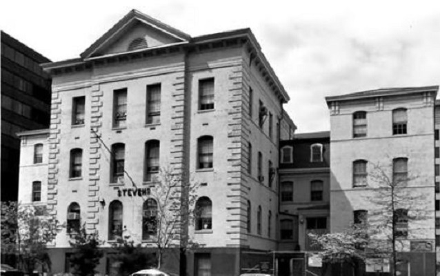 Black and white photo of four-story school made of stone. Courtesy NPS.
