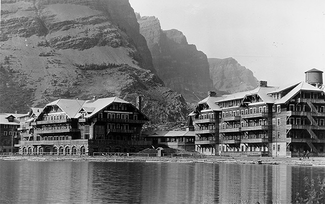 a view of the Many Glacier Hotel taken in the 1920s