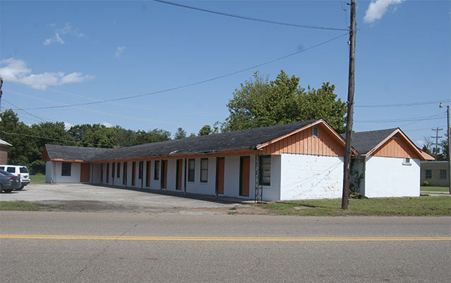 Booker T. Motel is a simple pair of single story, gable-front motel buildings