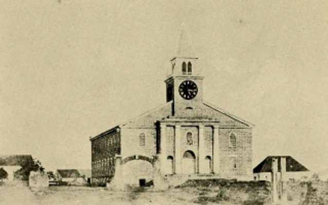 Black and white photo of a church with a cupola.