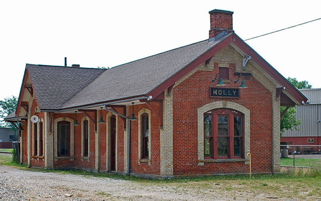 Exterior of a one-story red brick railroad depot