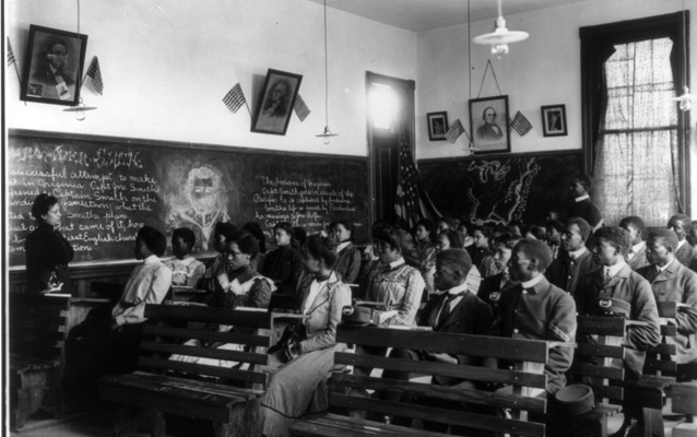 Tuskegee Institute students sit at desks