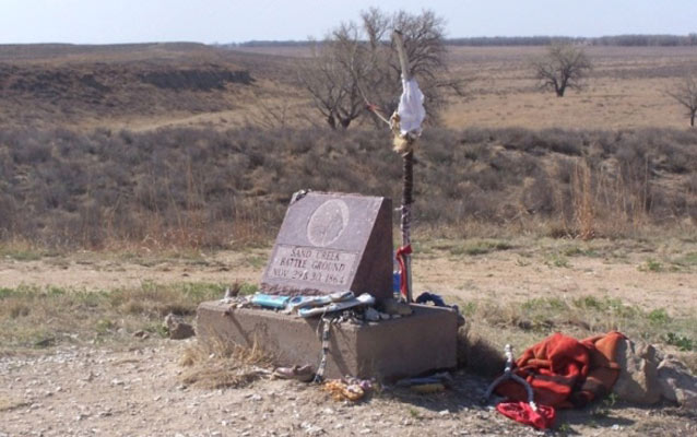 monument and red cloth in front of site