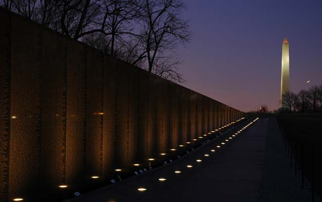 the Vietnam Veterans Memorial and Washington Monument at sunset