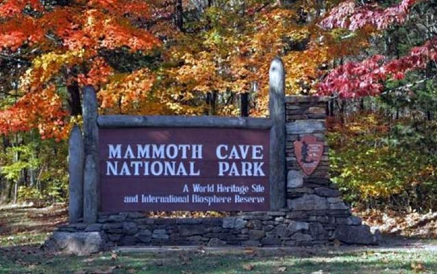the entrance sign to Mammoth Cave National Park in autumn