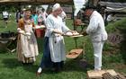 Volunteers and Friends of Valley Forge Park members demonstrate 18th century bread baking and cooking