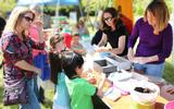 Families enjoying activities at Earth Day Birthday