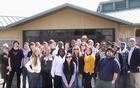 Park rangers and students in front of the visitor center