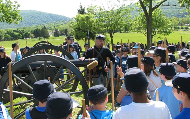 living historian talks about the artillery with students
