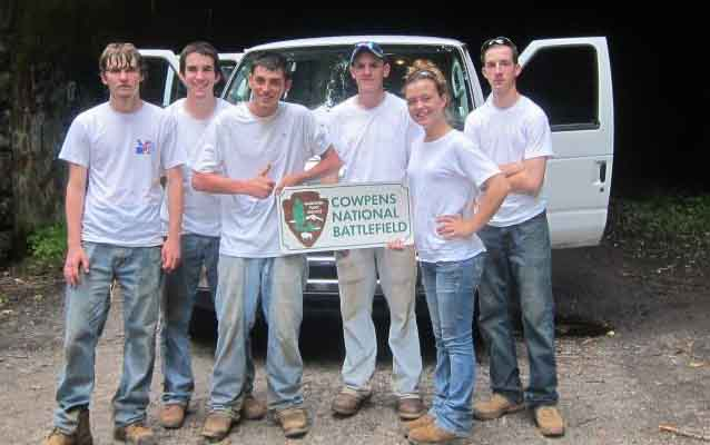 Cowpens National Battlefield YCC stand in front of their van at the tunnel leading to the Road to Nowhere.