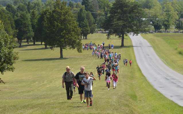 Harpers Ferry Middle School students hike with a ranger
