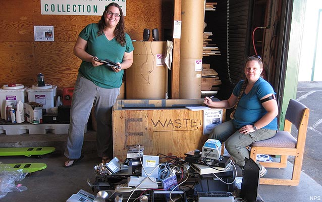 Facility Management Specialist Sara Hammond and IT Specialist Aimee Davis sort E-waste for recycling
