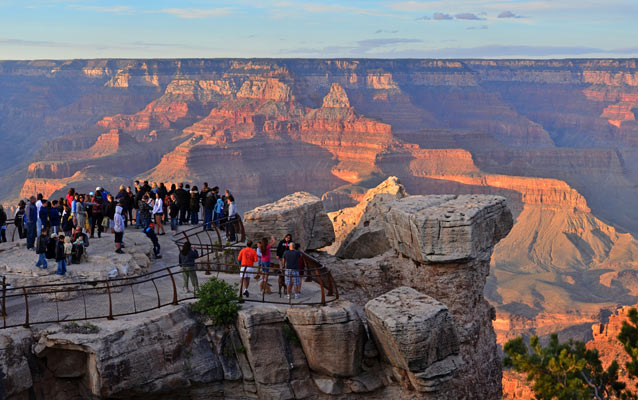 Visitors viewing sunset from Mather Point