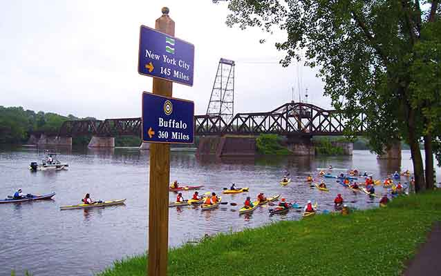 Canoes fill the Hudson River Greenway Water Trail between Buffalo and New York City.