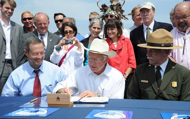 Secretary Ken Salazar signs the document designating four connecting components to the John Smith Trail.