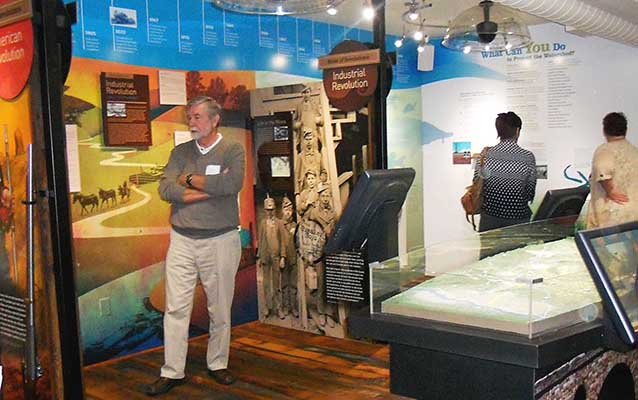 Visitors enjoy colorful displays on the Industrial Revolution at the center's grand opening.